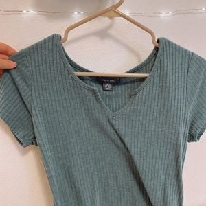 Green v-neck slightly cropped shirt
